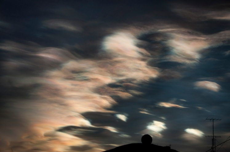 Polar Stratospheric Clouds. Chlorine reacts with ozone on the surface of these cloud droplets, depleting stratospheric ozone. Photo credit: Zhibin Yu/CIRES